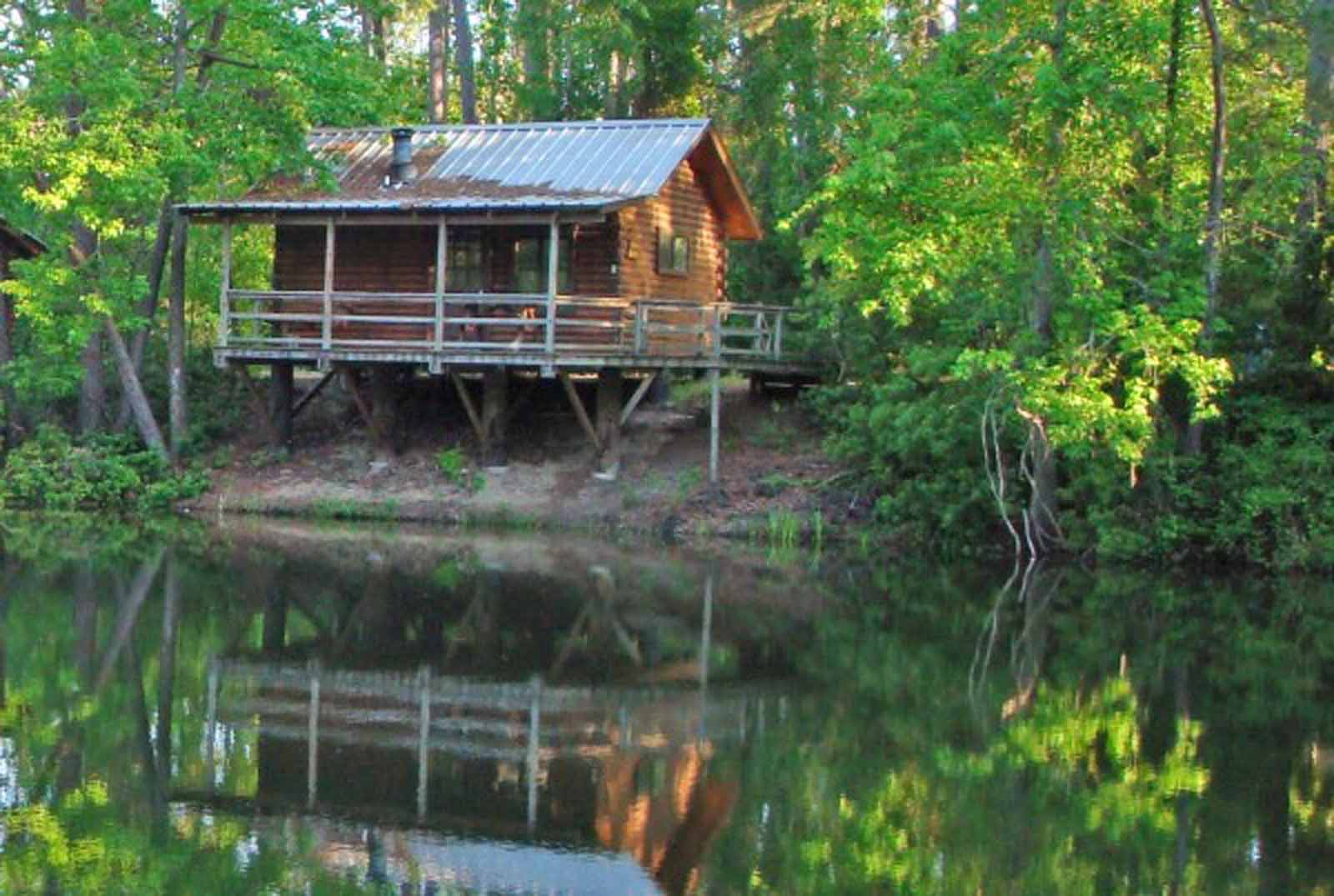 Cabins the retreat at artesian lakes for One room log house